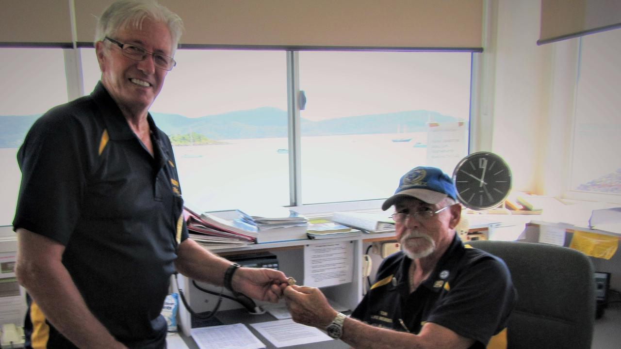 Retiring VMR Whitsunday volunteer Tom Manning, right, has been honoured by president Mal Priday for his 15 years of service to the branch.