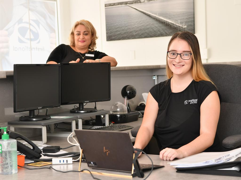 First National Real Estate Hervey Bay selling principal Jacqueline Farag (left) shows new recruit Nikayla Hamlin the ropes at the agency's Charlton Esplanade office. PHOTO: Alistair Brightman.