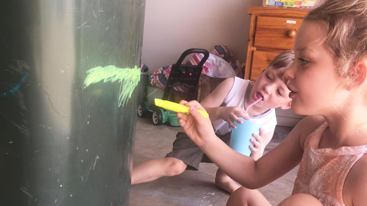 Laela and Xavier painting their wheelie bin.