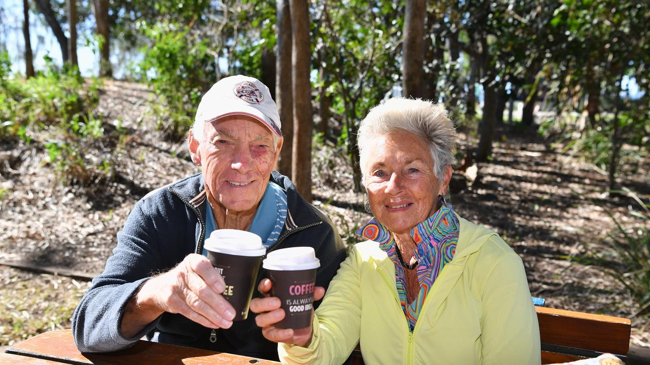 The morning coffee tastes so much better when you can sit and enjoy it, instead of drinking and exercising at the same time - toasting their new found freedom near Urangan Pier are Gary and Sandi Trim from Urraween. Photo: Alistair Brightman