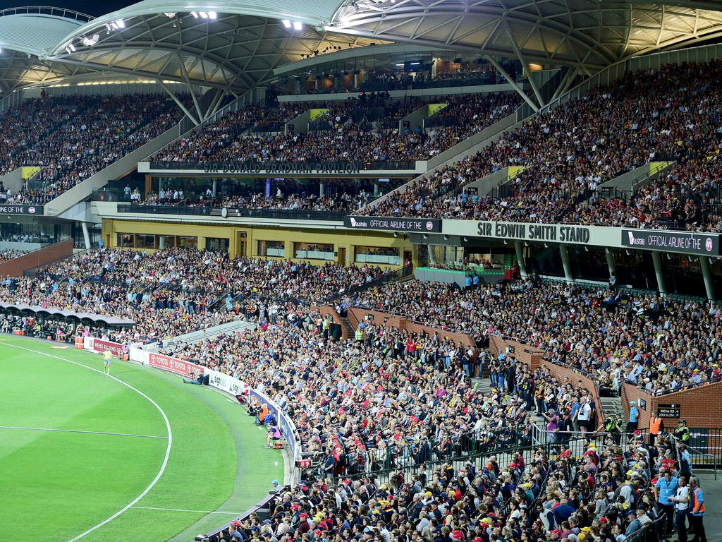 Packed crowds at Adelaide Oval catch a game between the Adelaide Crows and the Geelong Cats. Getting bums on seats will be a challenge even after lockdown. Picture: Bianca De Marchi