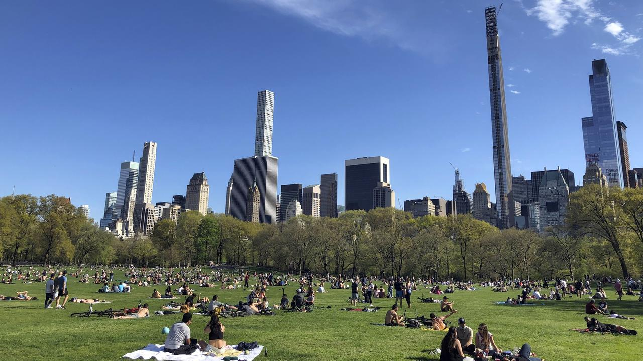 People practice social distancing while enjoying the nice weather at Central Park's Sheep Meadow, Saturday, May 2, 2020, in New York. Picture: AP /Ronald Blum.