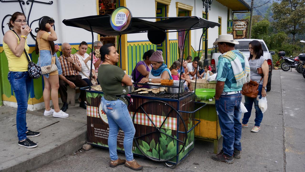 From hombres playing pool to families shooting at a games board to win prizes, Salento in Colombia is one of those colourful country towns with infinite charm. And delicious food.