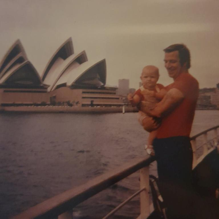 Terry holding baby Tina on a Sydney ferry to Taronga Zoo.