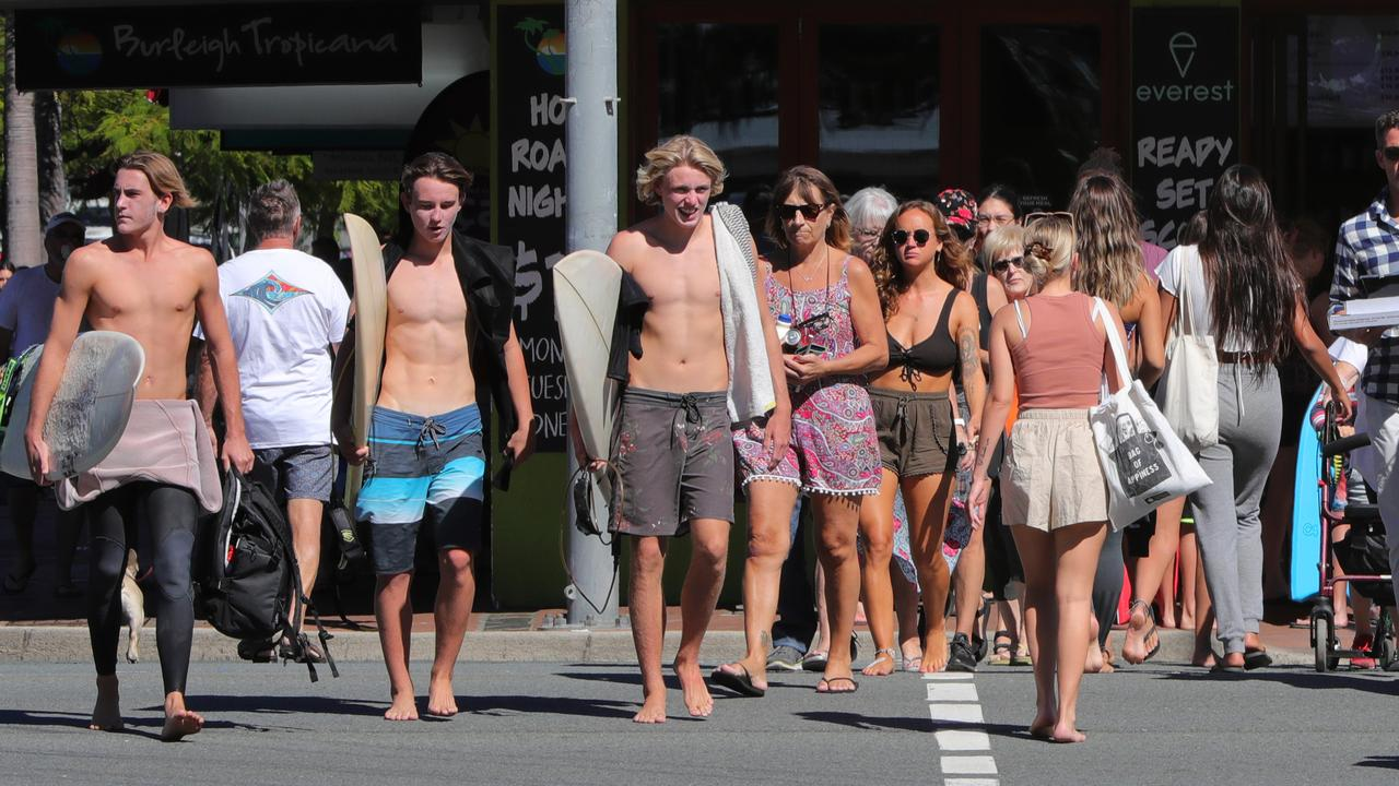 Crowds yesterday were well behaved at Burleigh Heads but in some areas, like the Connor St pedestrian crossing, social distancing became impossible. Picture Glenn Hampson