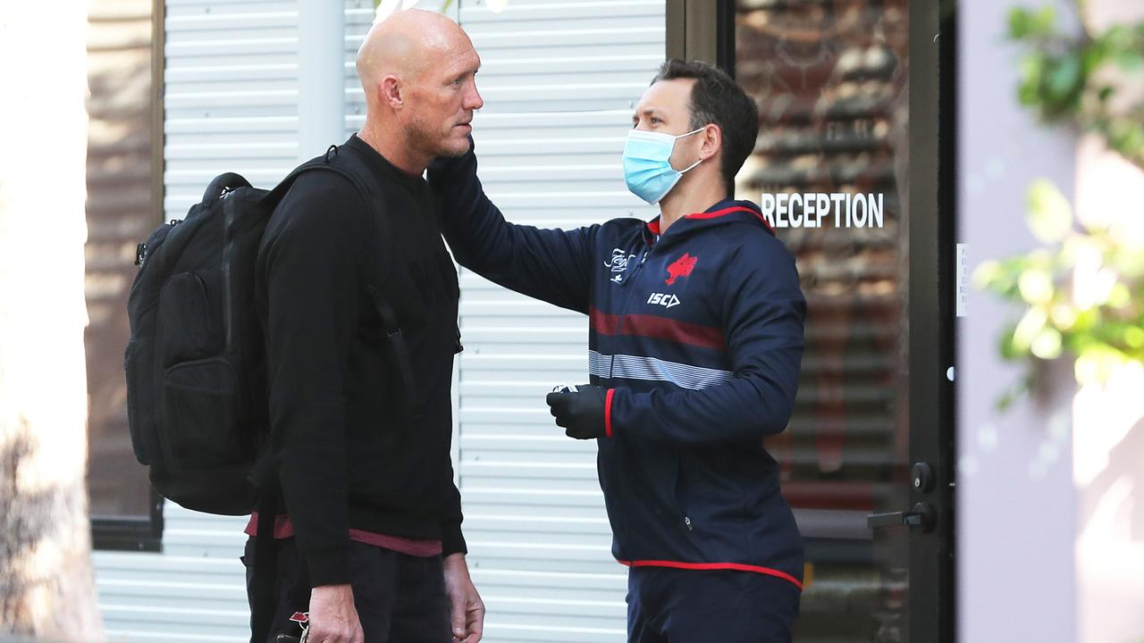 Roosters assistant coach Craig Fitzgibbon gets his temperature checked before training. Picture: Matt King/Getty Images