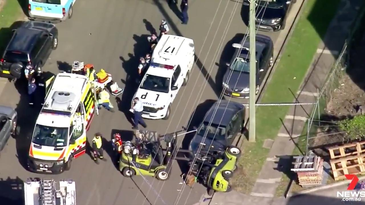 A man has died after he was crushed by a forklift outside a south west Sydney warehouse on Tuesday. Source: 7 News