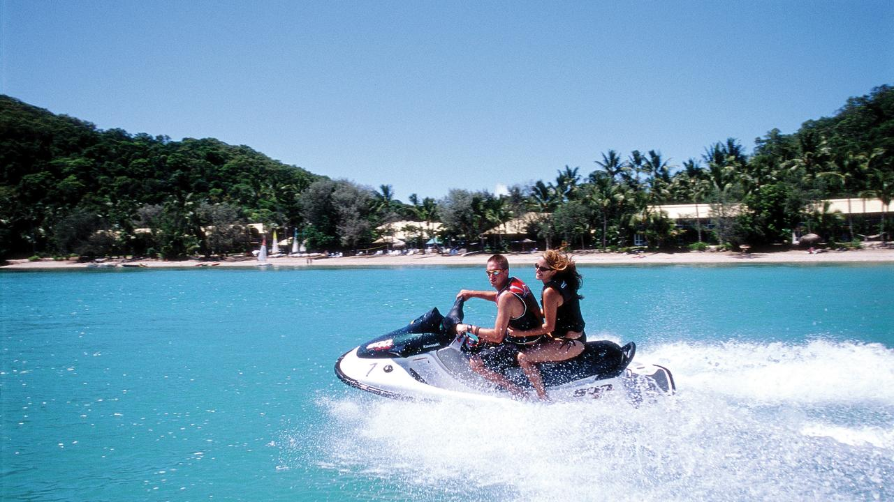 People skiing on jetski in Whitsunday Island, Qld. islands tropical holiday queensland water sports /Queensland