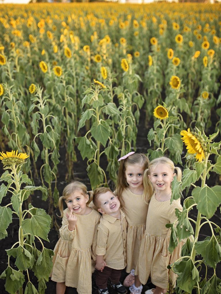 Isla Stevenson, Spencer White, Ivy White and Eliana Stevenson at the sunflower patch.