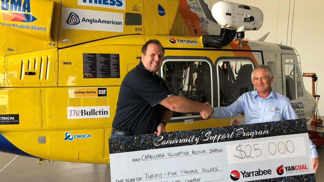 Tom Hayes, Environment and Community Superintendent from Yancoal's Yarrabee Coal Mine happily donating $25,000 to Mark Fewtrell, Executive Director RACQ Capricorn Helicopter Rescue Service (shaking hands prior to the current health crisis).