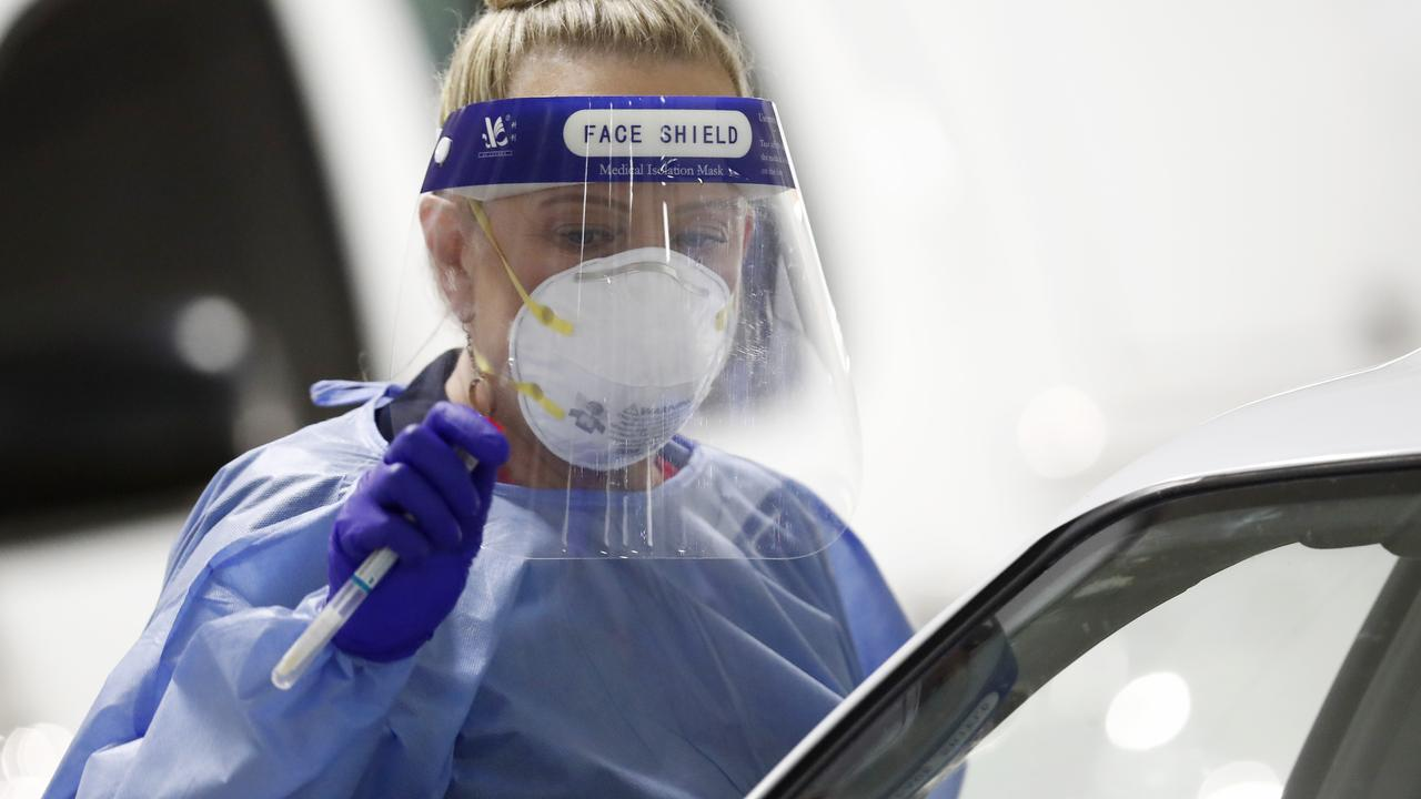 A medical practitioner at a drive through testing clinic in the carpark of Bunnings in West Footscray in Melbourne. Picture: Getty Images