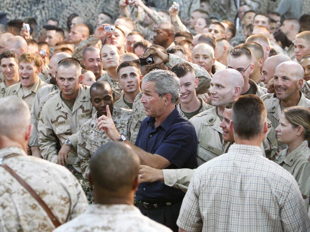 US President George W Bush greets troops at Al-Asad Airbase in Anbar province, Iraq, 2007.