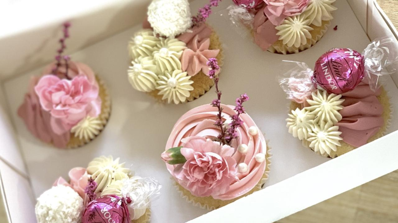 Our artisan bakers are pulling out all stops to make Mum feel super-special this year with indulgent cakes made with love like these gorgeously styled deluxe cupcakes from Baked by Melissa.