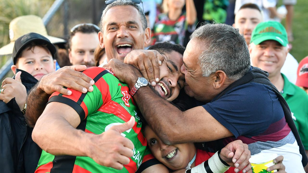 Cody Walker (centre), of the Rabbitohs, is seen being kissed by his father Bernie Walker (right) as he celebrates winning the Round 5 NRL match between the South Sydney Rabbitohs and the New Zealand Warriors at Sunshine Coast Stadium on the Sunshine Coast, Saturday, April 13, 2019. (AAP Image/Darren England) NO ARCHIVING, EDITORIAL USE ONLY