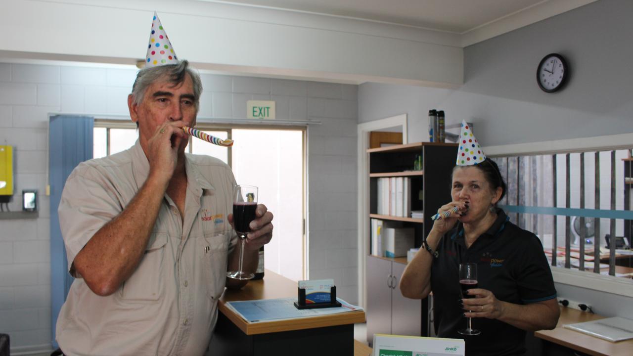 Murray Kay and Angela Sophios celebrating 10 years of Solar Power Gladstone.