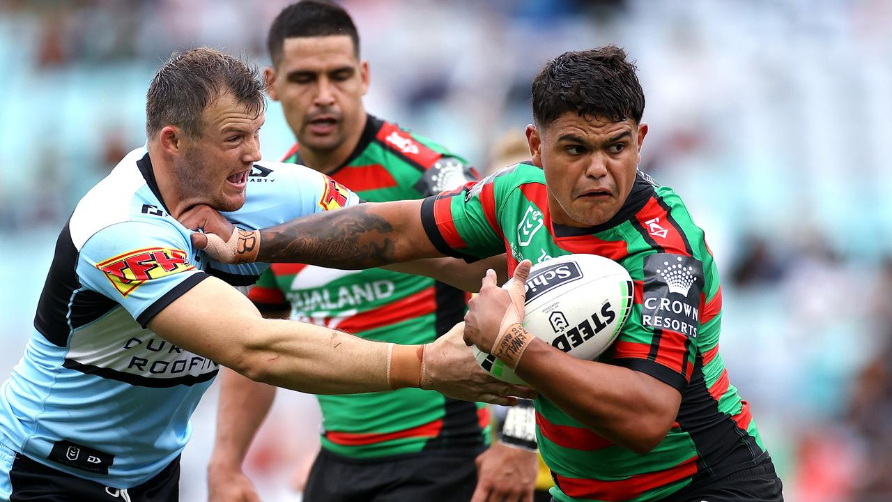 Latrell Mitchell fends Cronulla's Josh Morris during NRL match between the South Sydney Rabbitohs and the Cronulla Sharks at ANZ Stadium. Picture. Phil Hillyard
