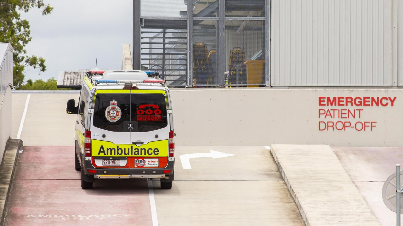 An ambulance at Logan Hospital, where there was a 10 per cent increase in patients at the emergency department in February and a 3 per cent surge in ramping. AAP Image/Richard Walker