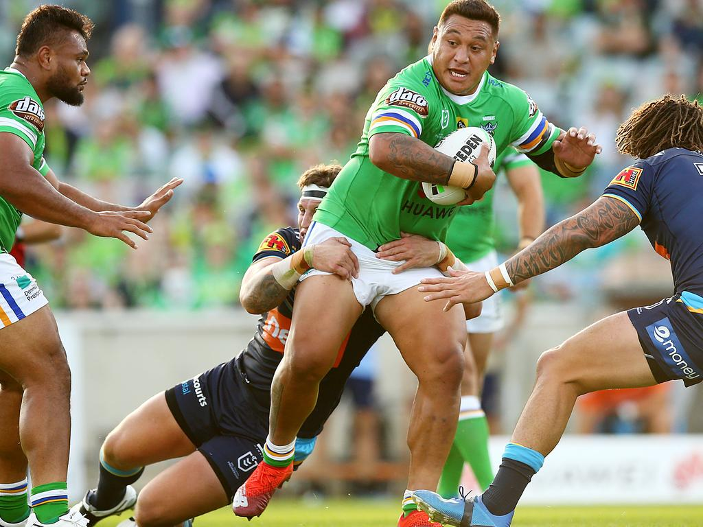 Josh Papalii of the Raiders runs the ball during the round 1 NRL match between the Canberra Raiders and the Gold Coast Titans.