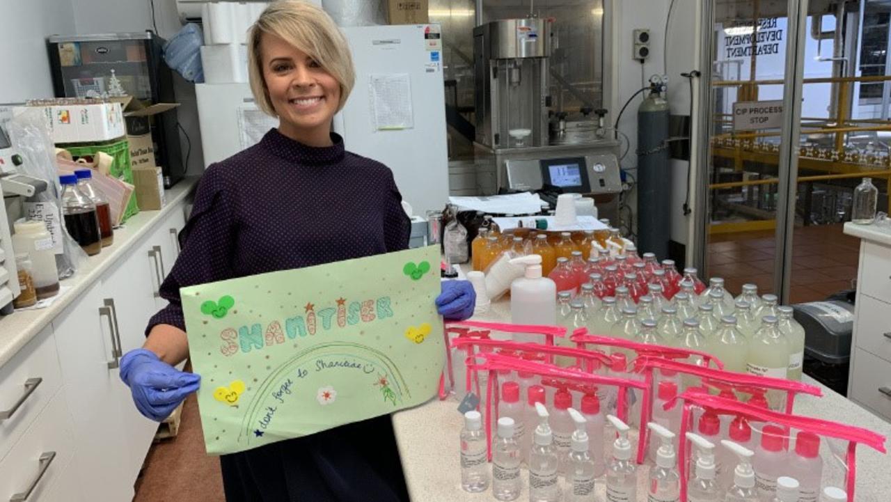 LENDING A HAND: Shannon Grosjean, New Product Development Technologist, with bottles of