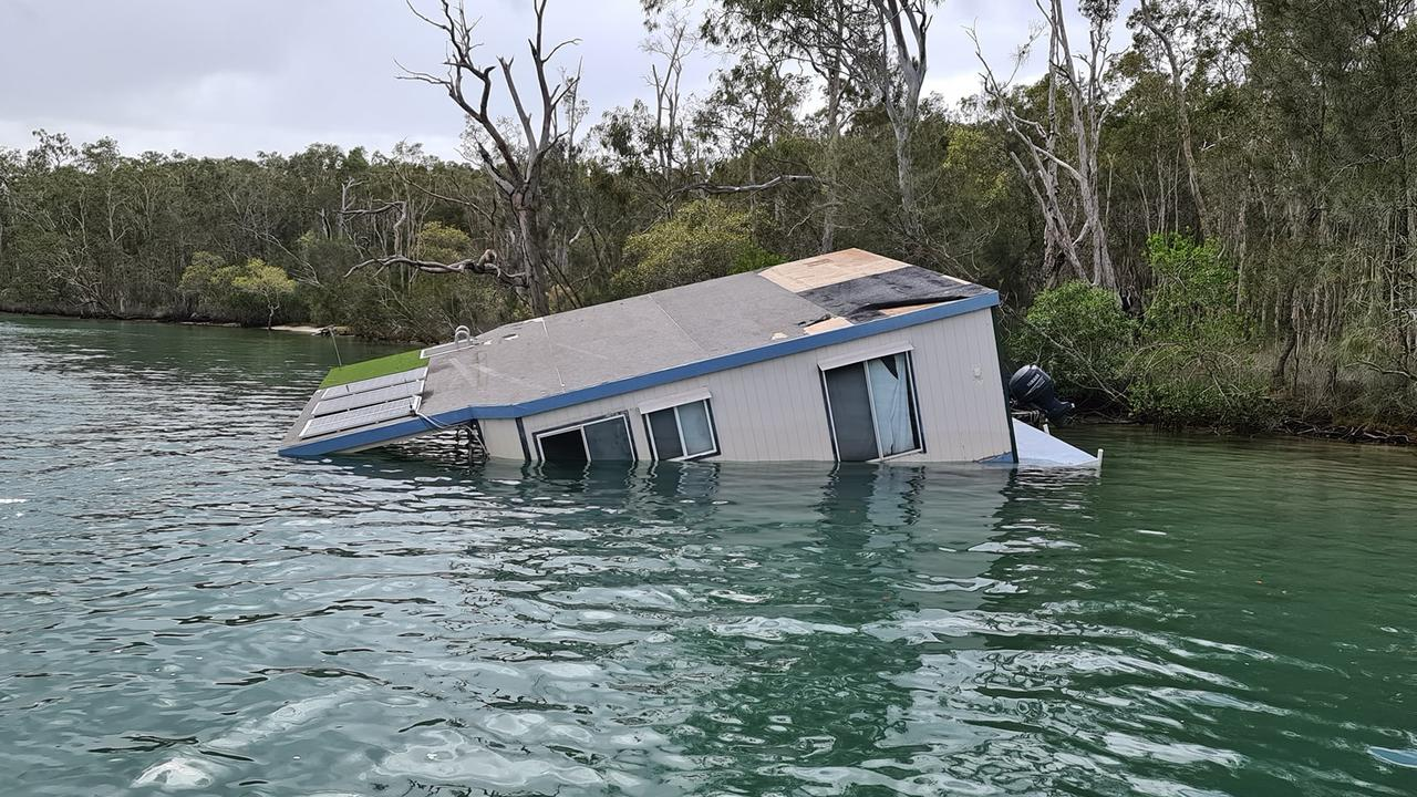 SINKING FEELING: Houseboat submerged on Noosa River.