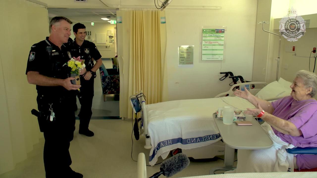 Queensland Police constables Max Gillet and Glenn Engels visiting Erika Freingruber in QEII hospital