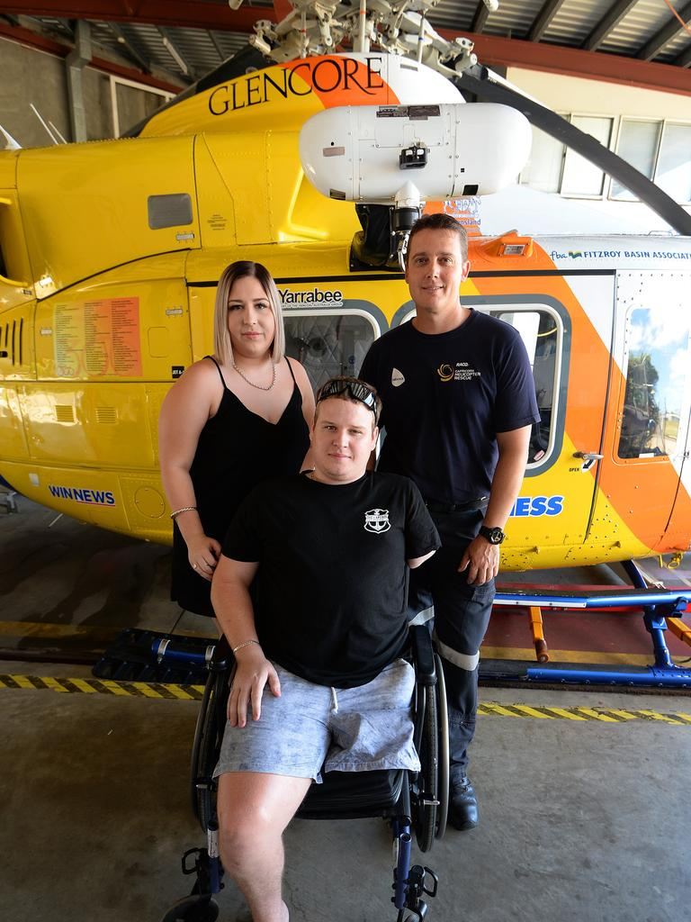 L-R Teneile Davis, Dayne Ladbrook and Nathan Triffett. Dayne visited the RACQ Helicopter Rescue Service hangar to thank them for saving his life and also made a donation. Nathan Triffett was one of the crew that responded to the Bajool crash back in 2015.