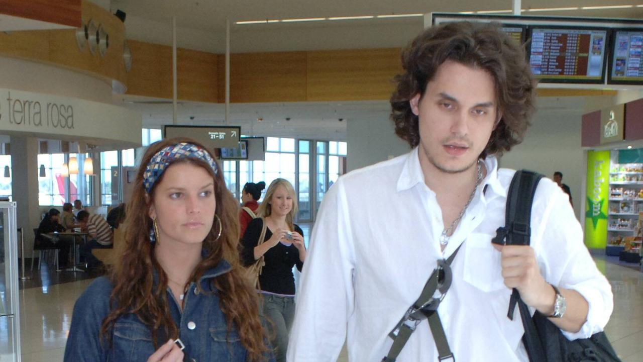 Singer Jessica Simpson with John Mayer at Adelaide airport.
