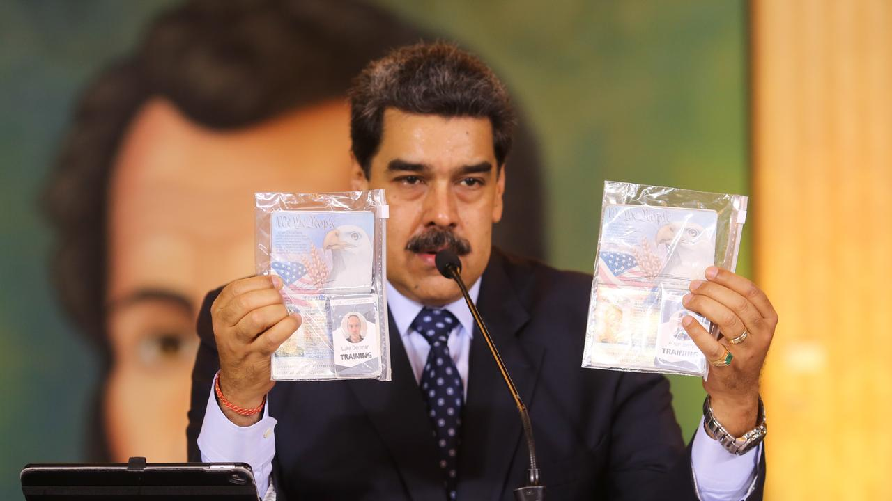 President Nicolás Maduro shows what Venezuelan authorities claim are identification documents of former US special forces and US citizens Airan Berry and Luke Denman during an online press conference. Picture: Miraflores Palace presidential press office via AP