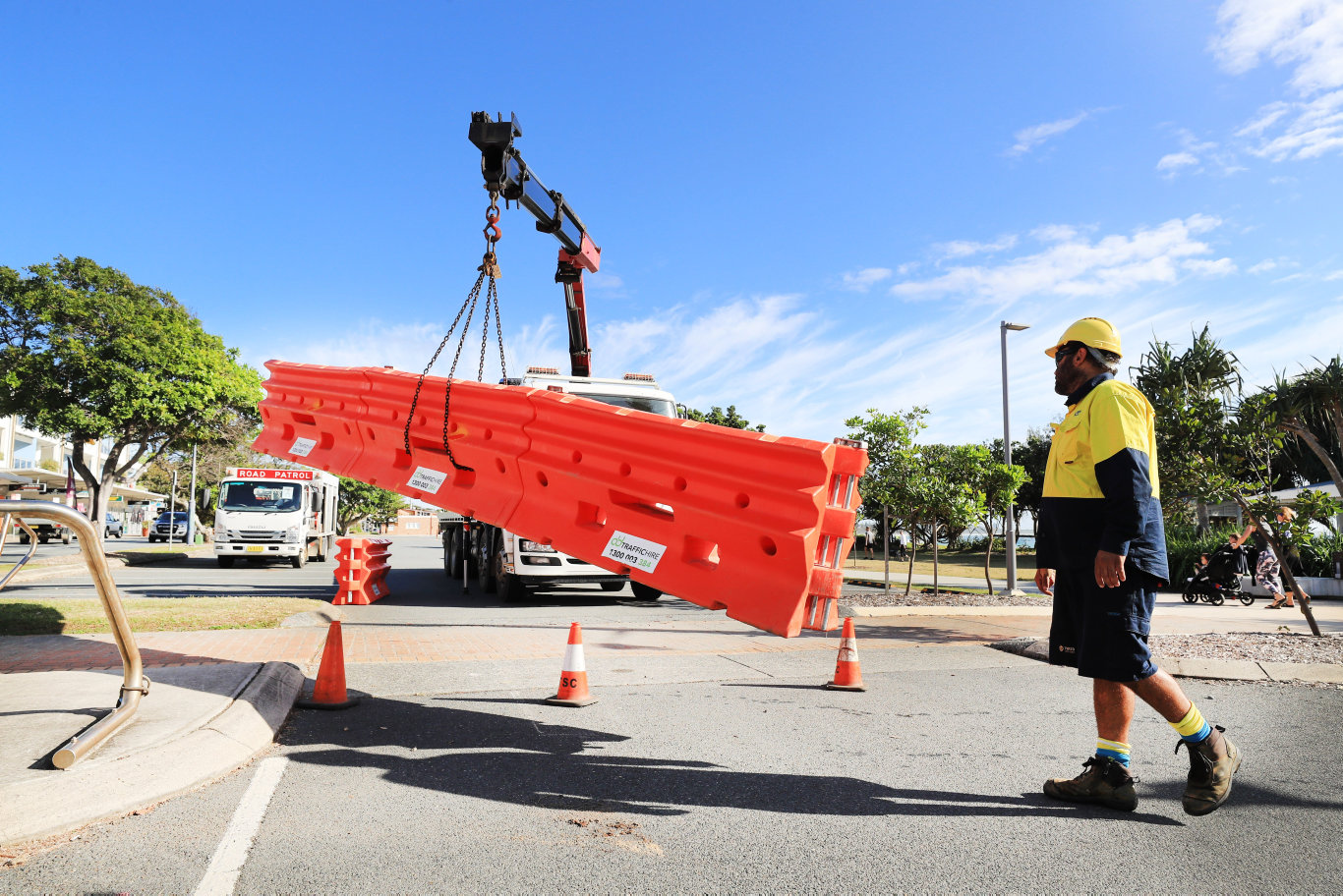 Tweed Shire Council staff remove barriers from the Tweed Coast Coucil parking areas.Photo Scott Powick Newscorp
