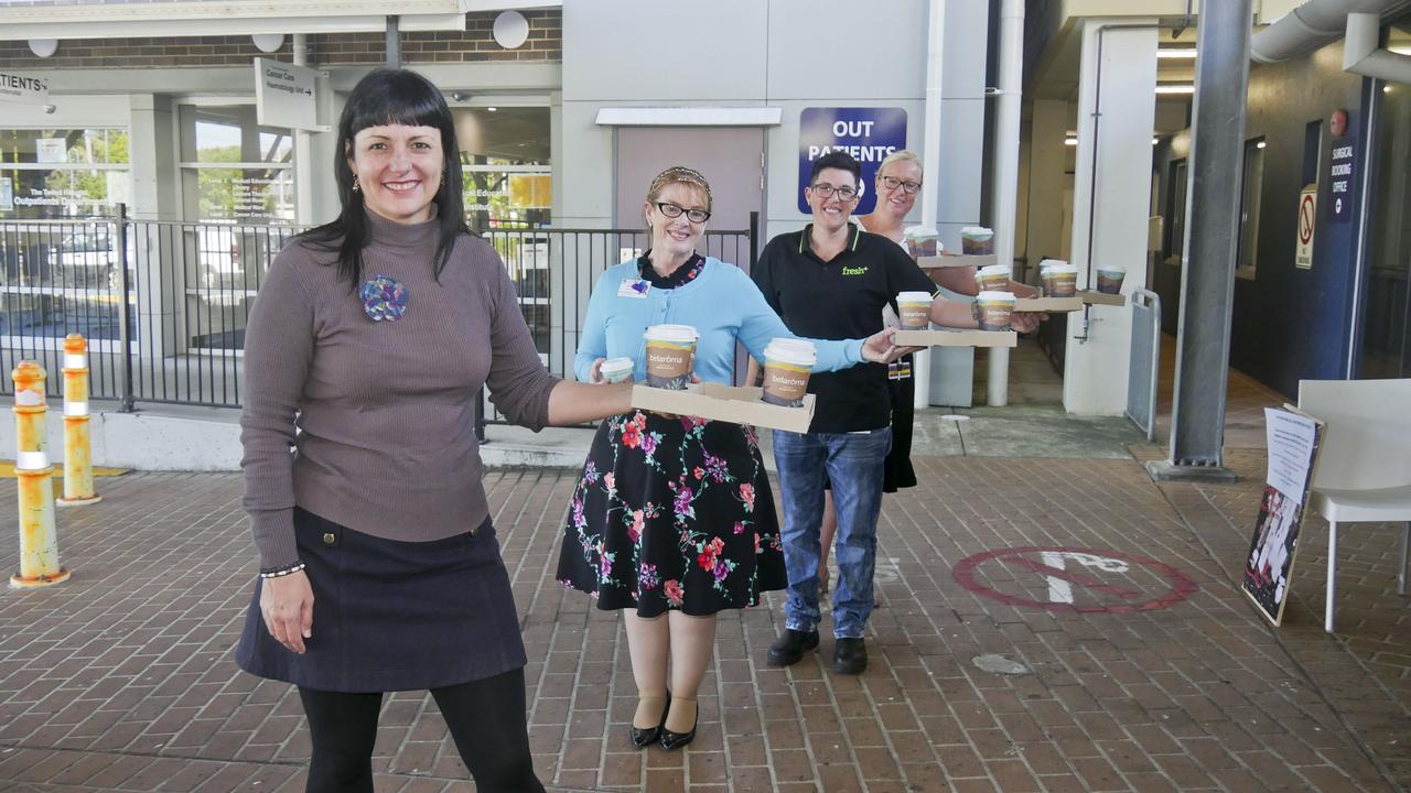 Our Kids' Rebekka Battista, nursing administration manager Myra Drummond, business manager Linda Goodwin and Fresh Plus Cafe manager Kristy Olsen (practising social distancing) at Tweed Hospital in preparation for a fundraiser to shout all hospital essential workers with a coffee. Photo: Jessica Lamb