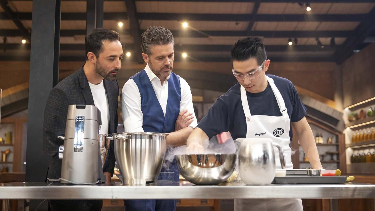 Andy Allen and Jock Zonfrillo watch contestant Reynold Poernomo on MasterChef Australia. Picture: Supplied/Tina Smigielski
