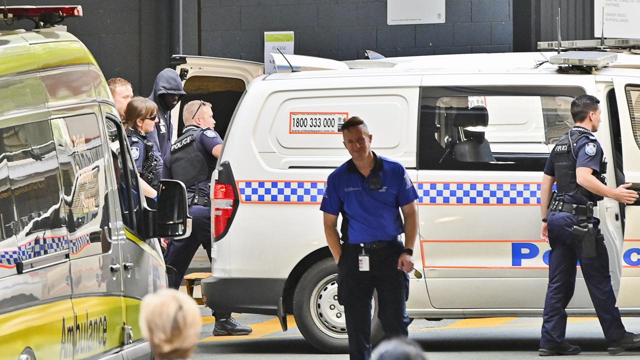 Majok Riel Majok, 18, from Redbank Plains is shielded from media view by police at Ipswich hospital when charged with biting a police officer. Picture: Cordell Richardson