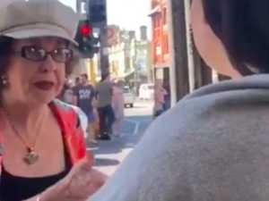 Bystanders shut down woman's racist rant