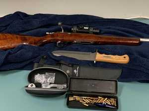 Man charged after rifle, knife and alleged drugs uncovered