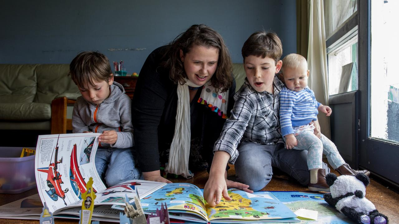 Arianwen Harris is homeschooling her sons Niyad, 5 and Ziad, 9, as well as looking after her one year old daughter Niya at their home. Arianwen thought she would never want to homeschool her children but is enjoying the experience. Photo: Sean Davey