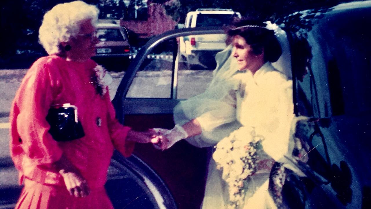 Mum greets me on my wedding day, ready to walk me down the aisle in 1986.