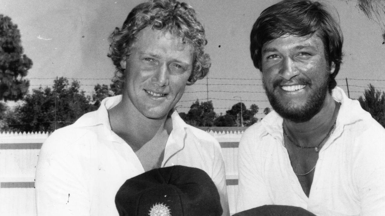 Australian cricket captain Kim Hughes (l) and Indian cricket captain Shivlal Yadav exchange caps at Adelaide Oval, 25 Jan 1981. They will both celebrate their birthdays on 26 Jan. (Pic by unidentified staff photographer)