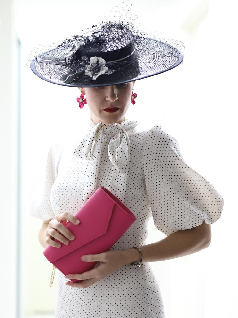 Raceway fashion has moved online with Andergrove resident Anna Dutton taking part in the Virtual Fashions Off The Field competition. Ms Dutton wore a black and white outfit she had created and her hat was made by Crazy Tea Pot.