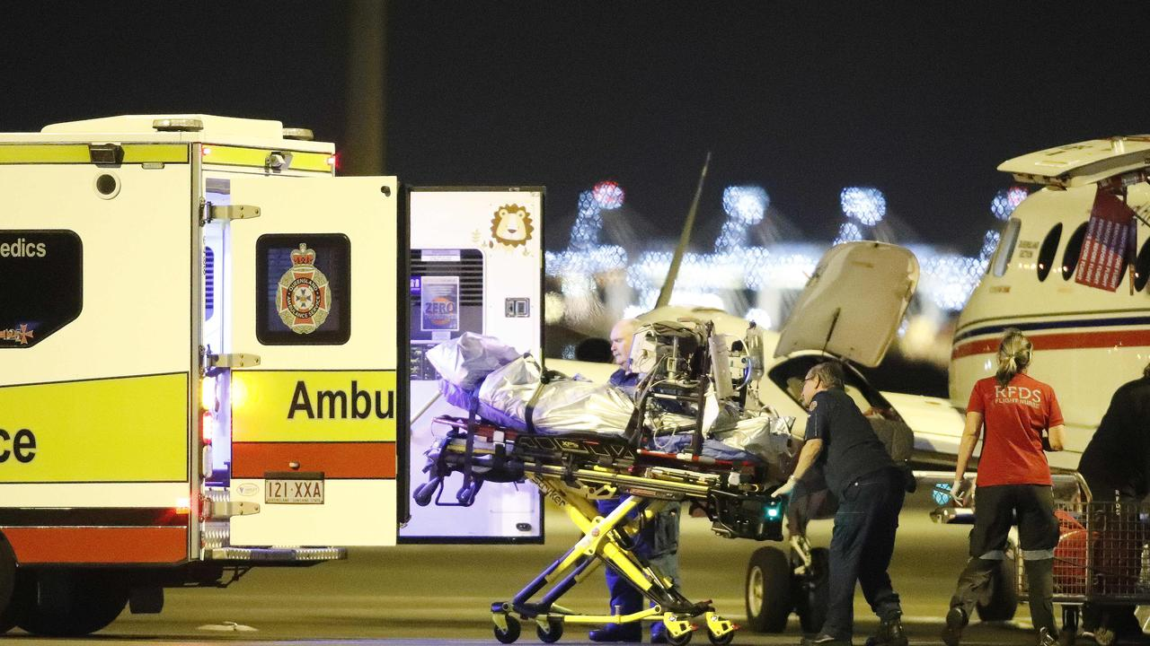 An injured person from an explosion at Grosvenor coal mine at Moranbah pictured arriving at the Royal Flying Doctors Service, Brisbane 6th of May 2020. This is the second flights to arrive after an explosion at the mine left five people seriously injured. (AAP Image/Josh Woning)