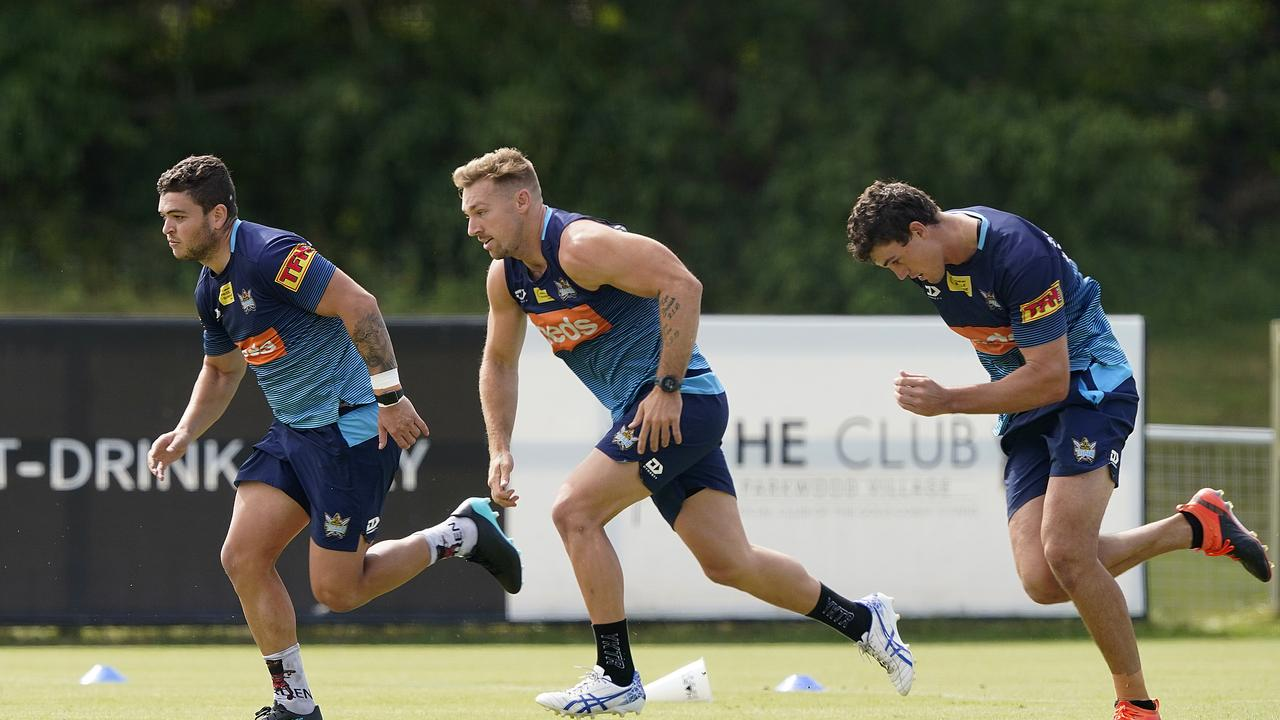LtoR; Ashley Taylor, Bryce Cartwright and Sam Stone run during the Gold Coast Titans training session on the Gold Coast, Wednesday, May 6, 2020. (AAP Image/Dave Hunt) NO ARCHIVING