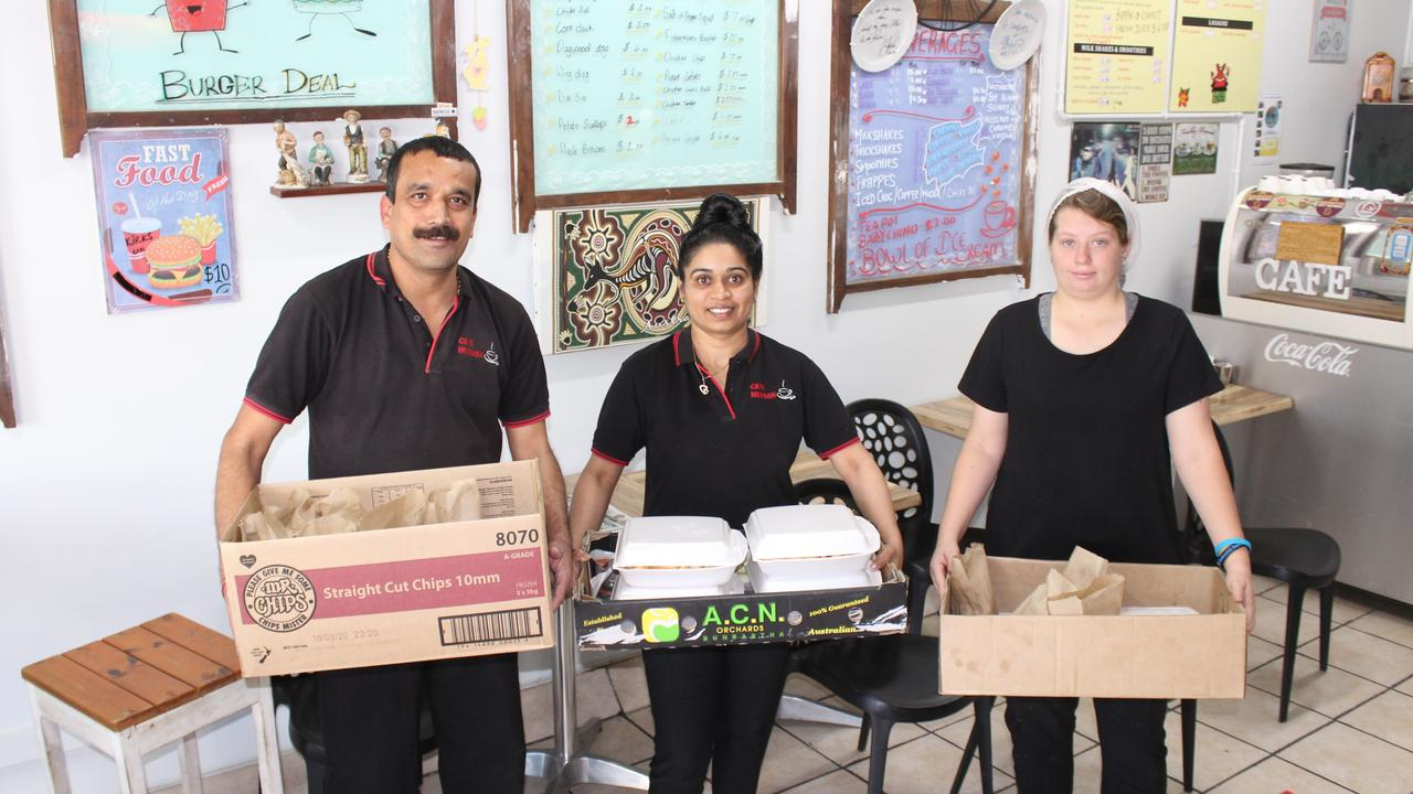 Cafe Murgon owner Dhiren Parmar with workers Daya Parmar and Rochelle Dorman with the boxes of food for the Army squadron. Photo: Laura Blackmore