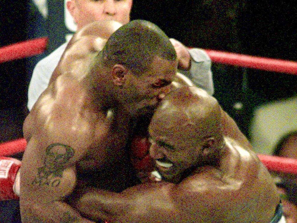 Tyson (left) infamously bites the ear of Evander Holyfield during WBA Heavyweight match in Las Vegas, 1997. Picture: Supplied