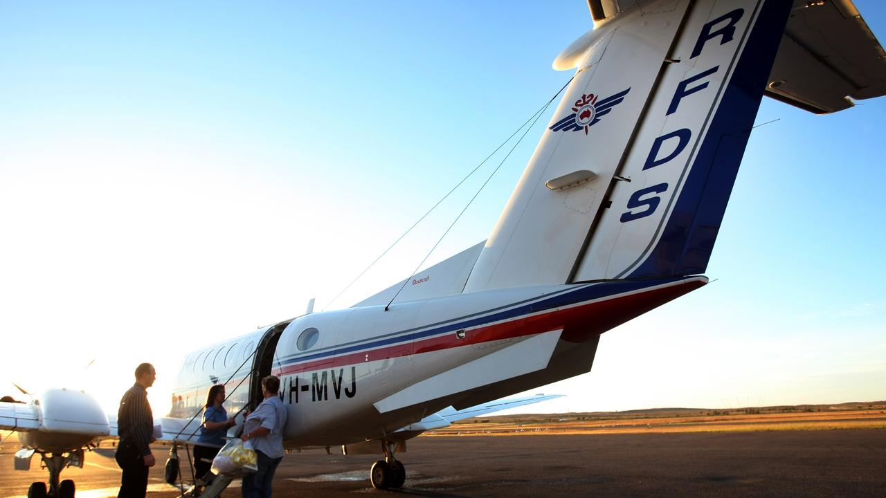Medical staff load up an RFDS plane at the opening of the Royal Flying Doctor Service base at Broken Hill.