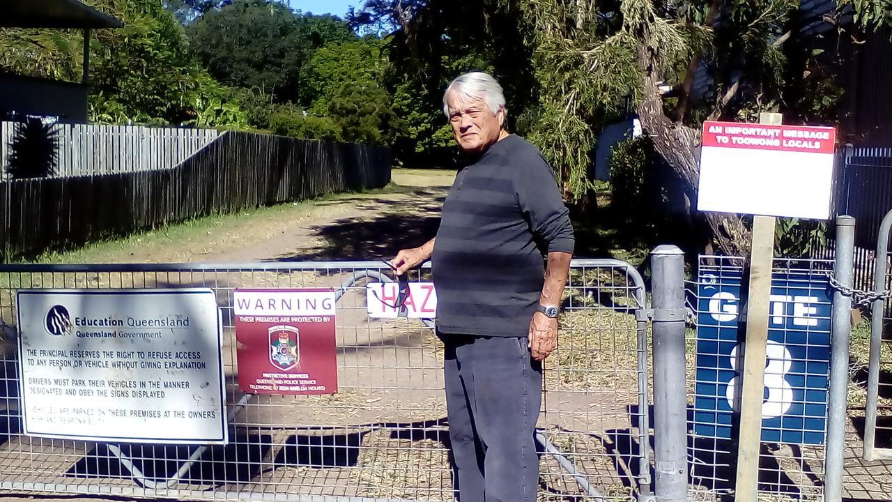 Taringa resident Ken at the locked gate at Vera St Common.