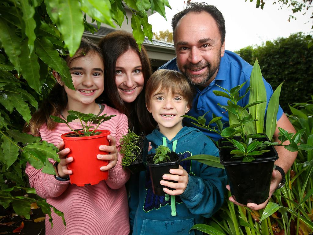 Julia and Jason Kloszynski, with their two children Zara, 10 and Ryan, 8, are saving hundreds of dollars a week during the COVID-19 lockdown period. Picture: Ian Currie