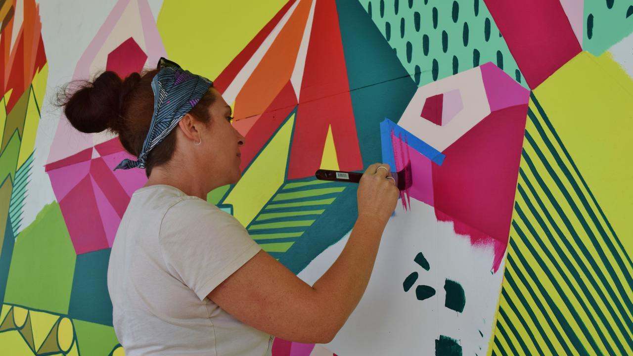 STREET ART: Regina Hyland working on the Chinchilla Placemaking Project. Pic: Peta McEachern