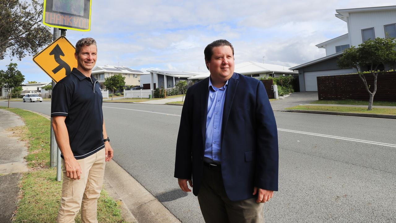 Tweed Shire councillors James Owen and Reece Byrnes next to the 'smiley face' speed sign in Kingscliff. They are seeking funding for 10 more from the state government after a successful trial. Photo: Scott Powick