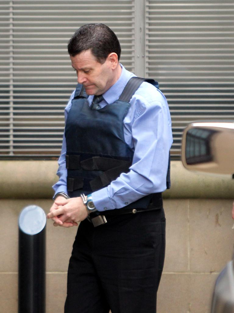 One of Australia's biggest ever rats in the law enforcement ranks, NSW Crime Commission assistant director Mark Standen being led into King Street Court in the Sydney CBD after being convicted of conspiring a mass drugs shipment. Picture: News Corp