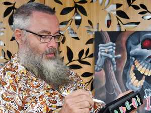 Tattooist beats boredom with political 'toons
