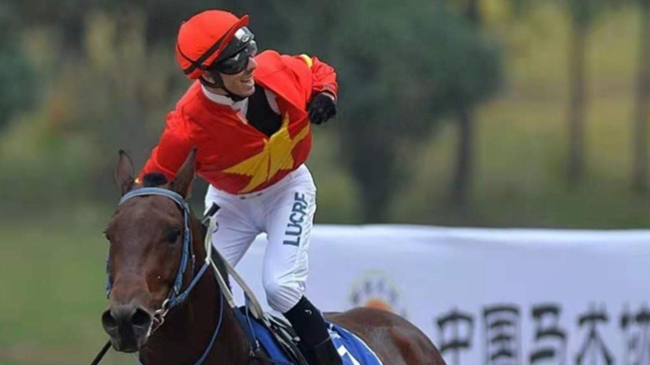 WINNER: Jockey Beau-Appo salutes the crowd after winning the International Invitation Stakes on Feitan at Wuhan racecourse in China last December.
